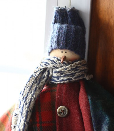 snowman with wool coat