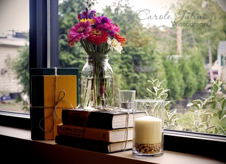 flowers and books in window for carole knits