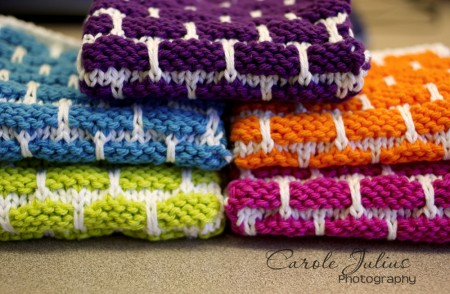 two stacks of dishcloths for carole knits
