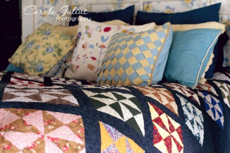 bed with quilt and pillows for carole knits