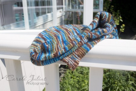 sea coast socks on railing folded for carole knits