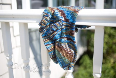 sea coast socks on railing for carole knits